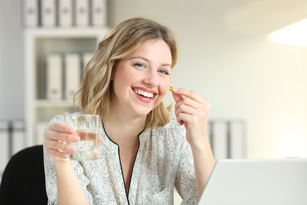 woman taking natural mood boosters