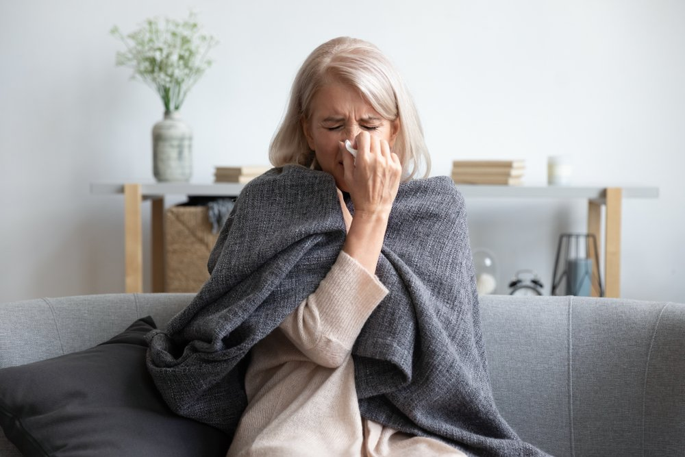 how to boost immune system - older woman sick on couch