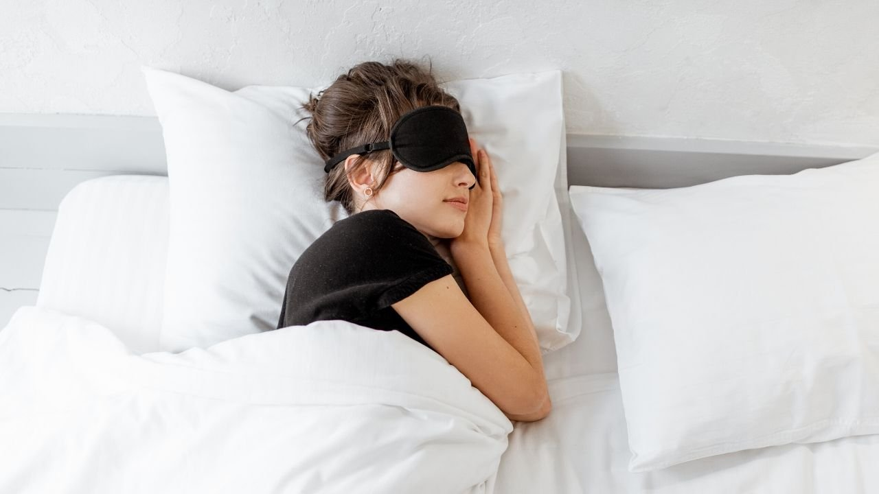 Woman sleeping with an eye mask on