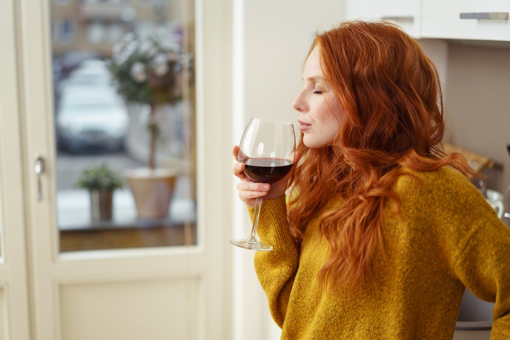 is wine healthy? woman drinking red wine