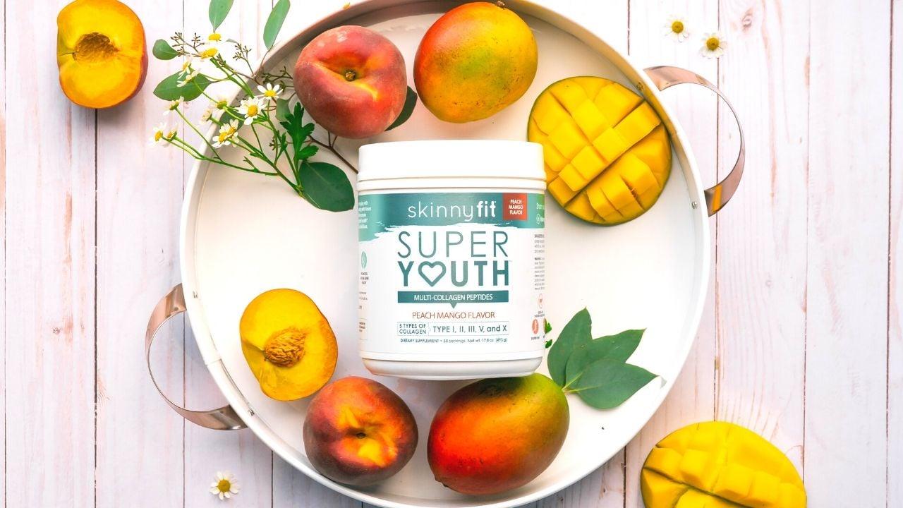 SkinnyFit Super Youth Peach Mango jar with mangos on a plate