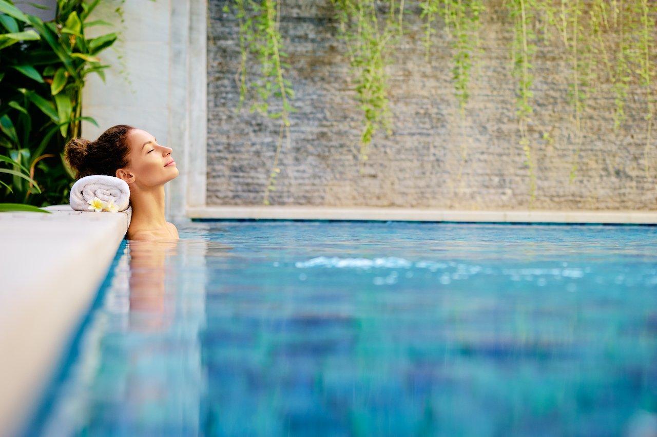 Woman relaxing in a prestine pool.