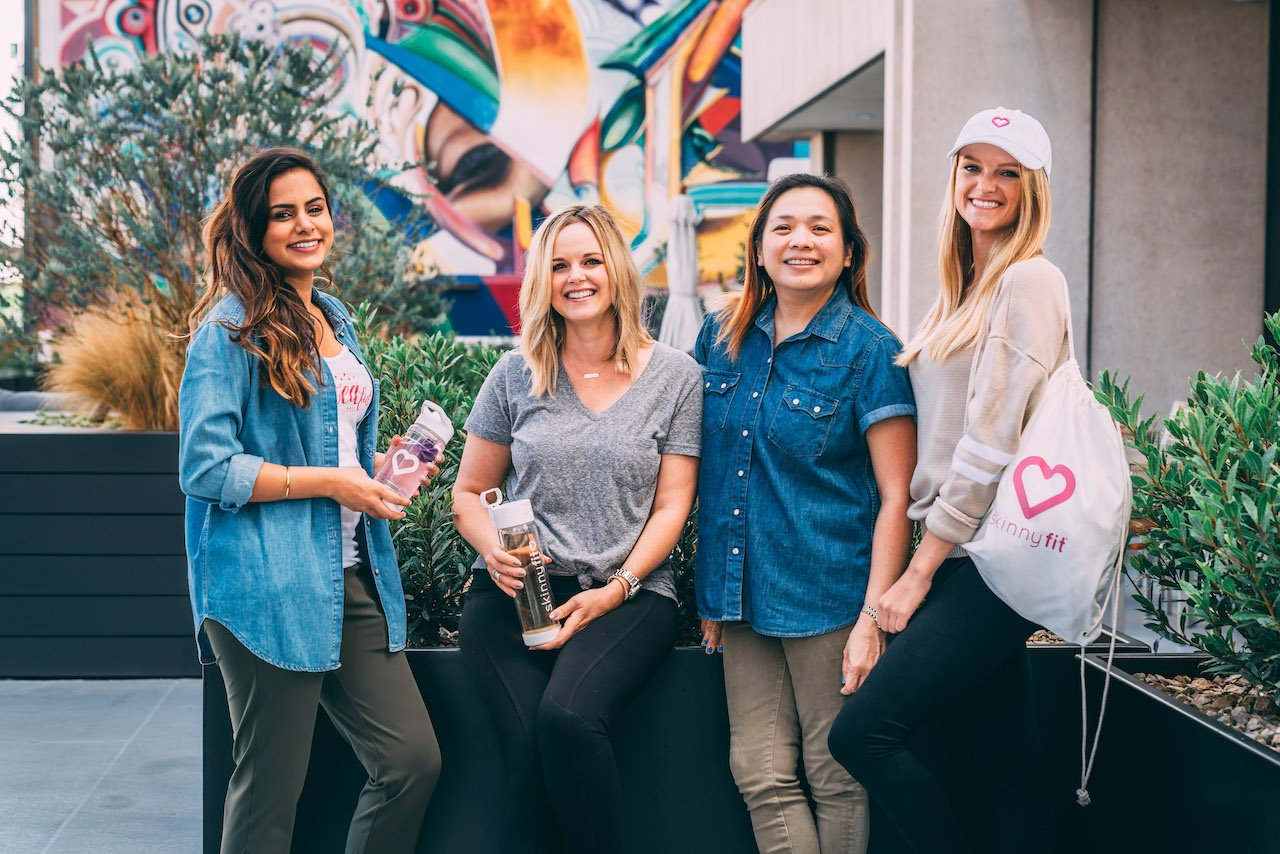 Four members of the SkinnyFit Community, a place women can turn for support for their health goals, including overcoming weight loss plateau.